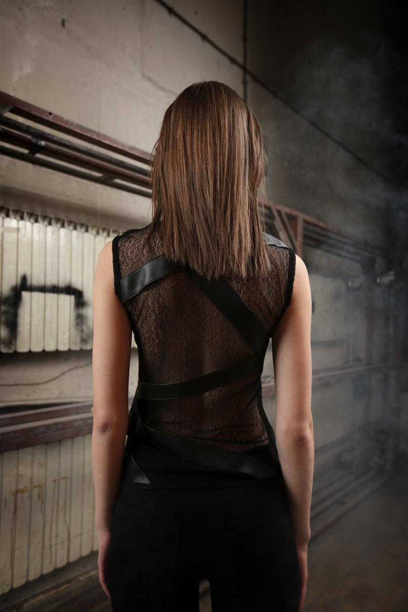 Black net top designed with vegan eco leather stripes front and back.