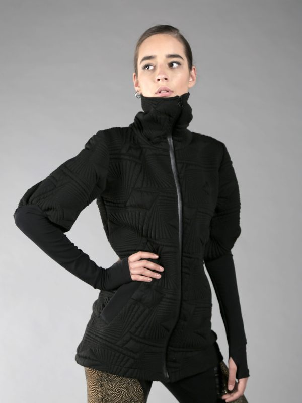 one layered thick women jacket with 2 pockets, long torso fit, finger holes, high neck.