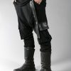 Black long loose pants for men designed with eco-leather and 2 pockets on the side