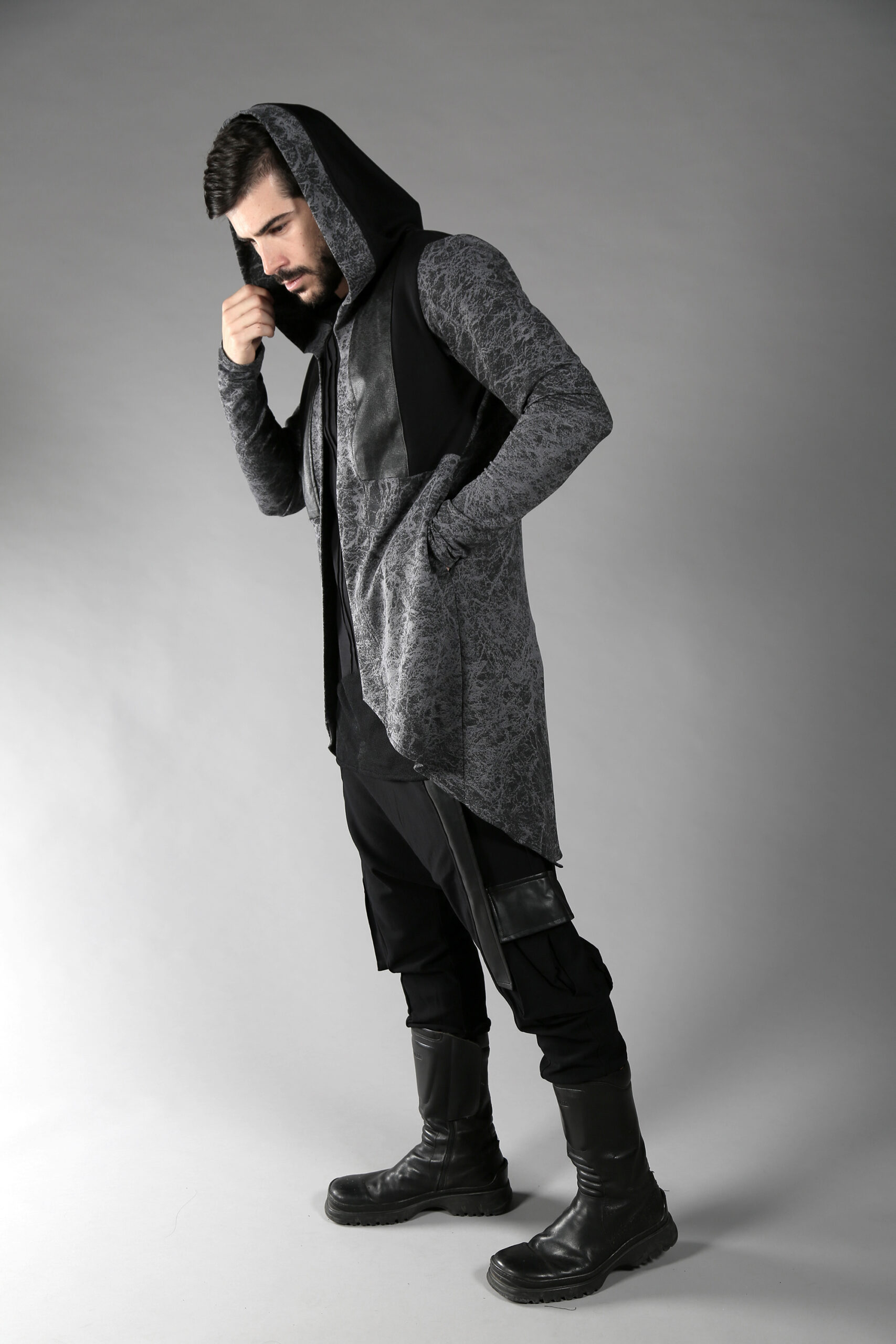 Asymmetric man cardigan with a very unique design. Made from Soft and thick cotton lycra designed with fake leather stripes in few patterns. Double layered big hood & 2 side pockets.