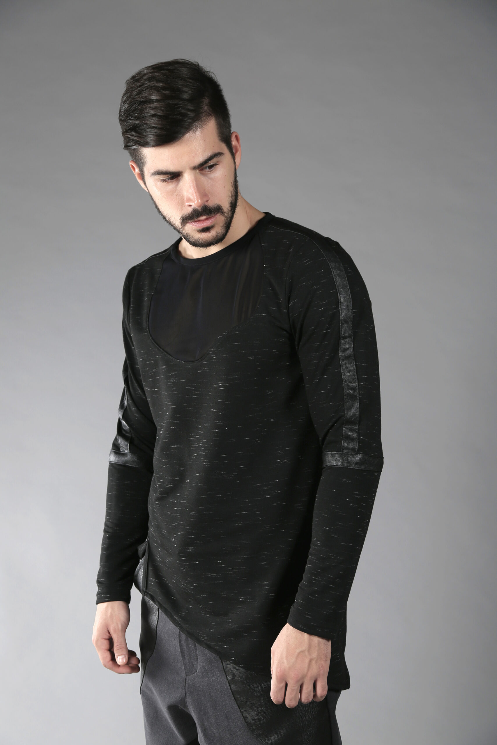Black men pullover made out of soft cotton lycra fabric which feels nice on your skin. This asymmetric top is designed with fake leather stripes and net free-form parts on front and back