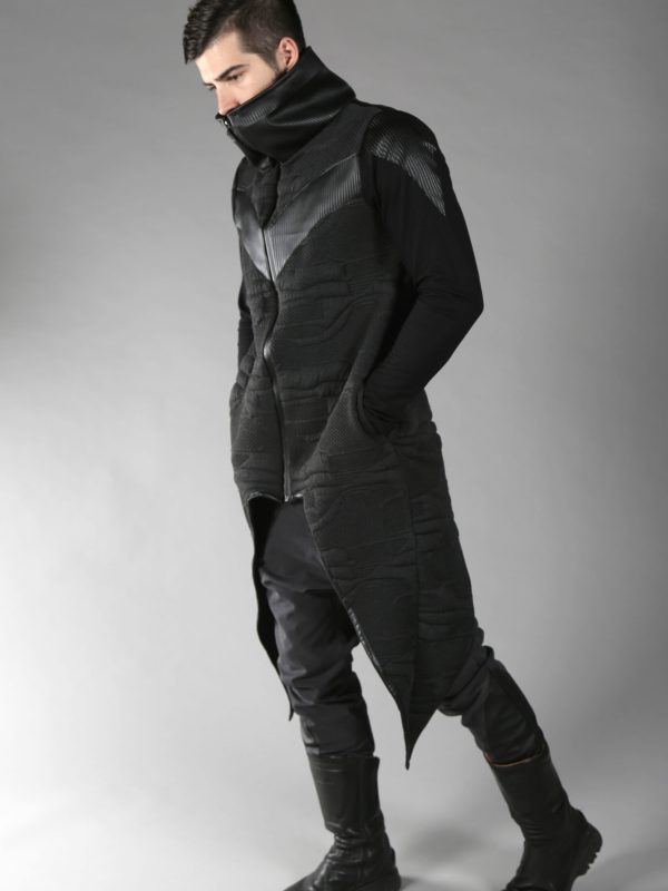 Dystopian long jacket/coat with high neck zipper closure, designed with fake leather front, back and side arms.