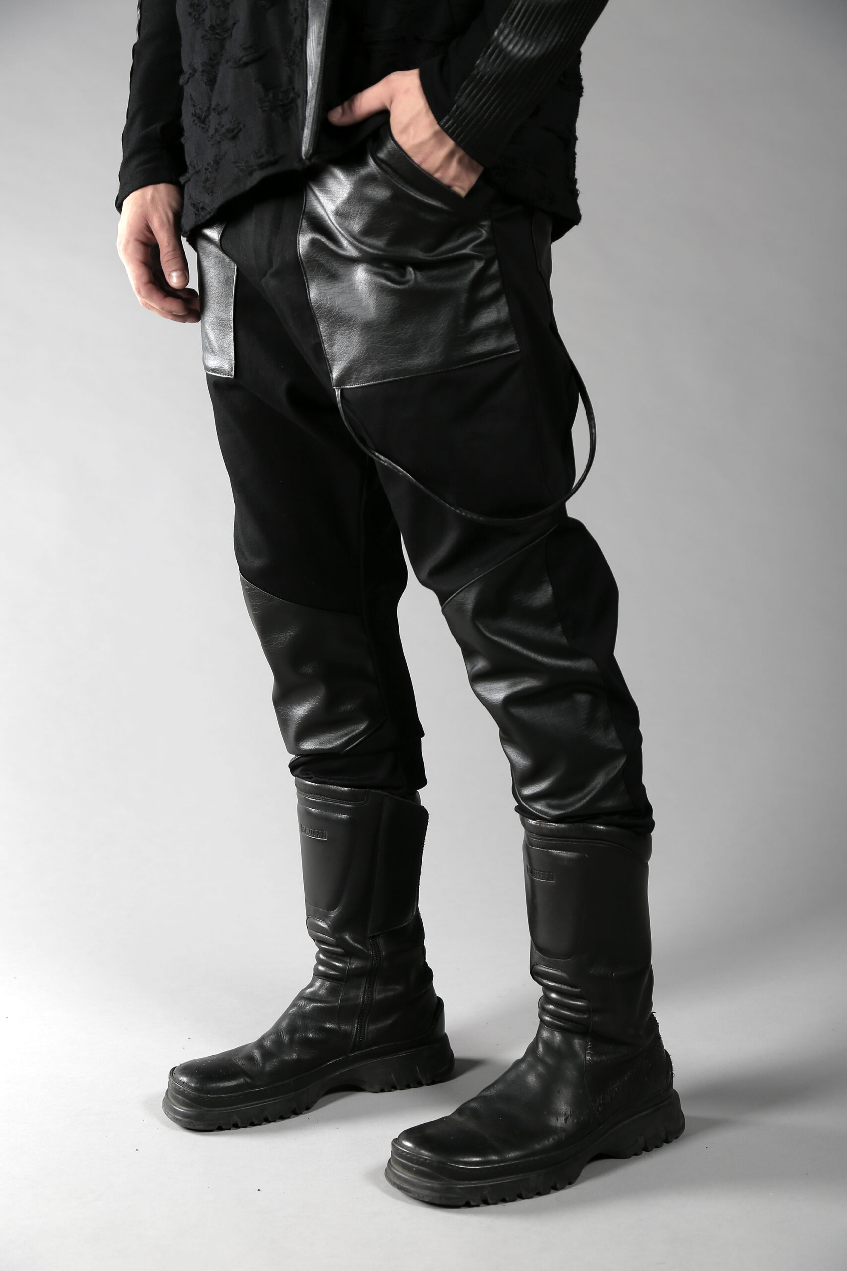 Black denim men pants designed with fake leather pocket on the front, leather pieces on the front lower leg and 2 pockets on back
