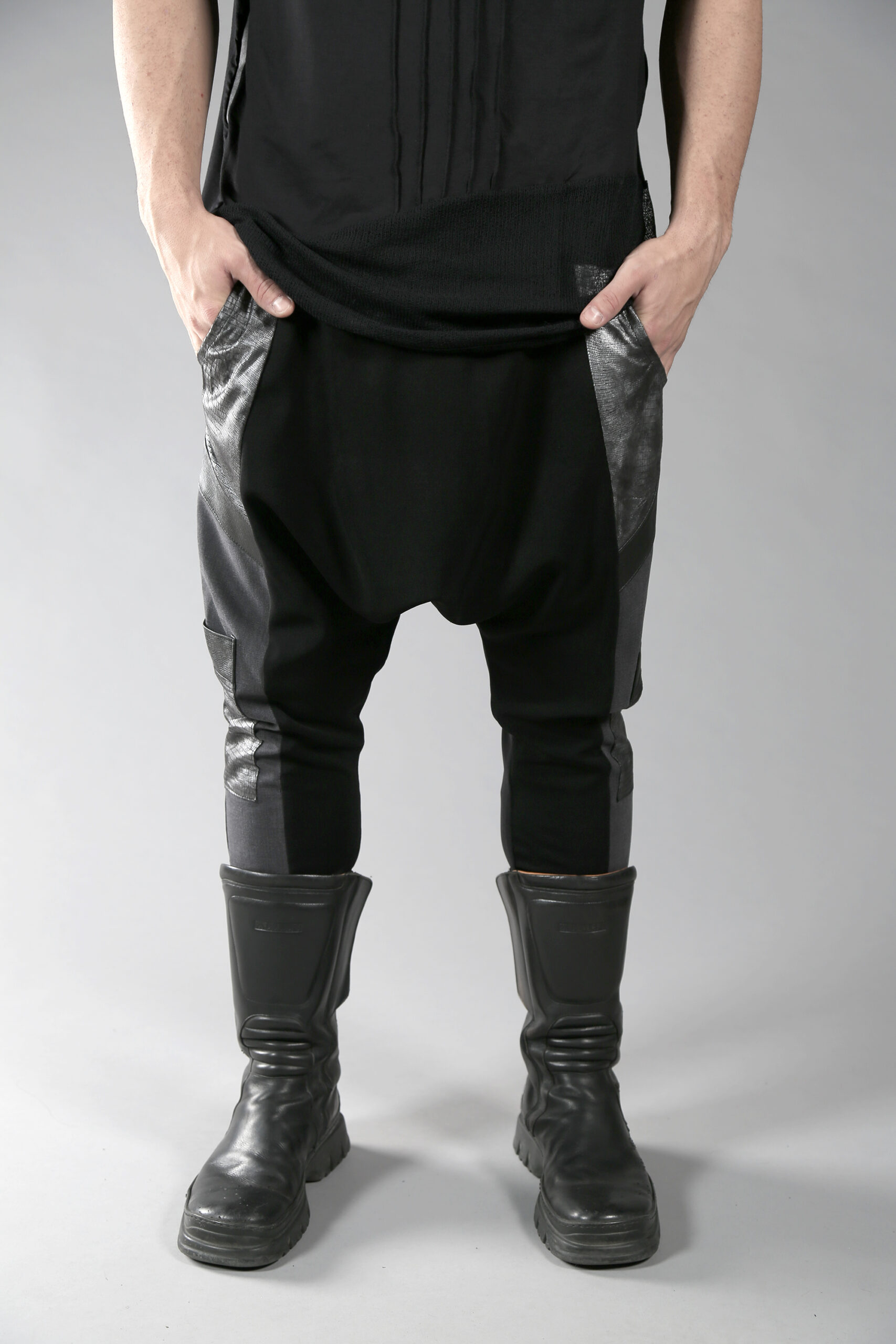 Black & gray long loose men pants designed with eco leather and 2 pockets on the side and lower leg