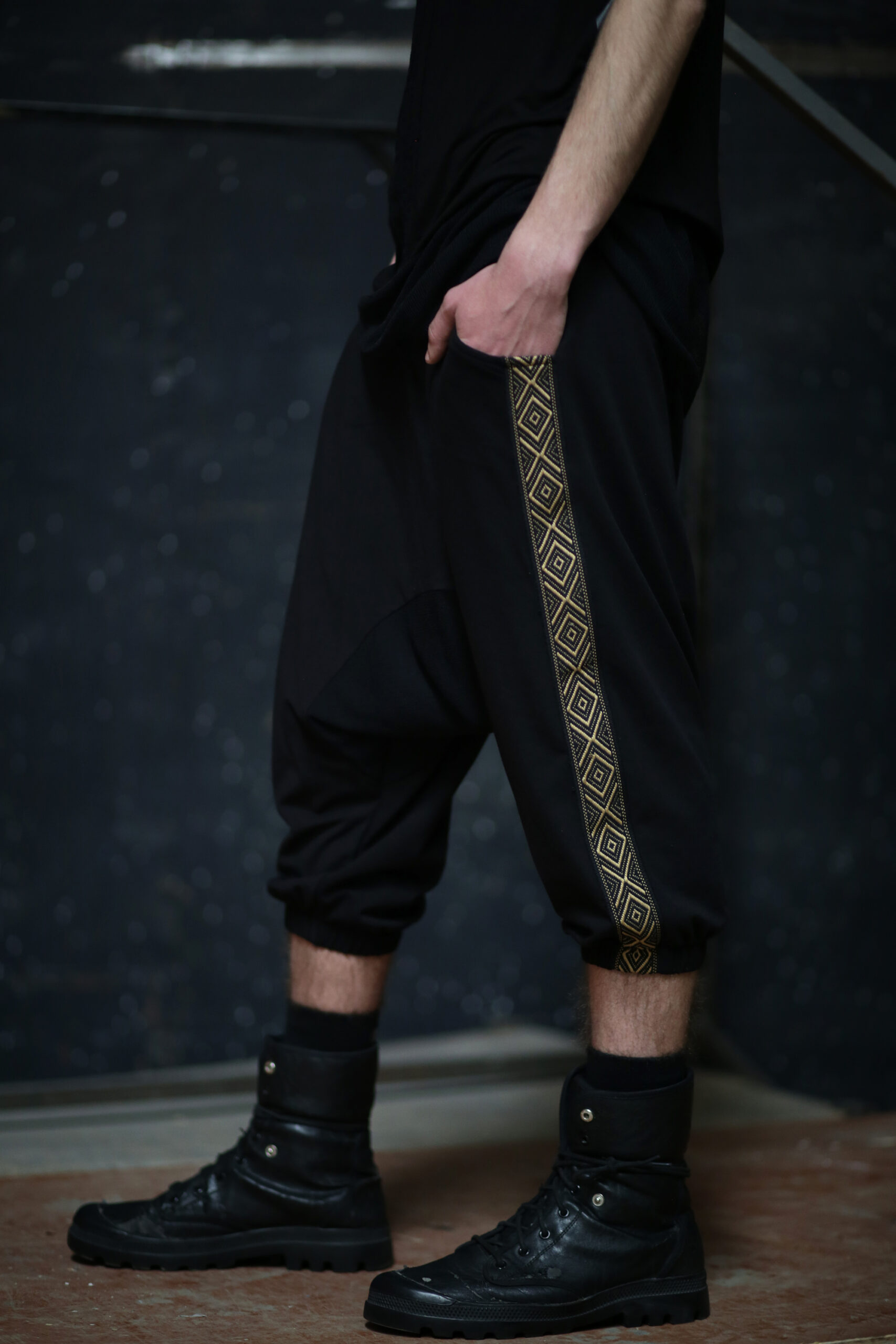 Men loose pants made from cotton lycra fabric, designed with 2 golden stripes