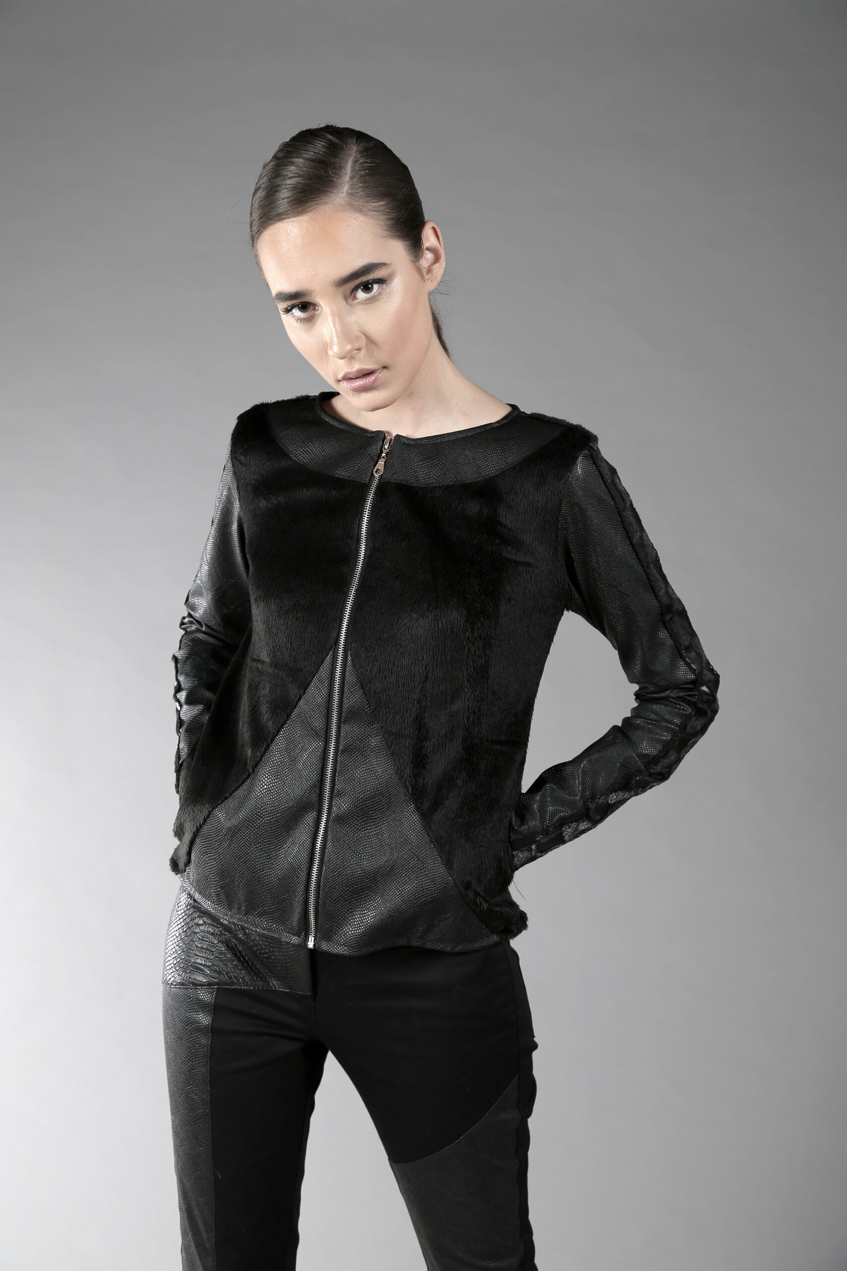 Black short jacket designed with fake leather. With lining.