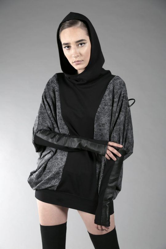 Amazing soft cotton lycra fabric with double layered hoodie. Fake leather details on the sleeves and back side.