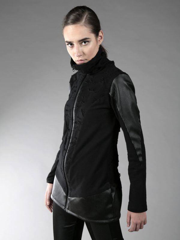 High neck thin jacket, made from 2 different types of cotton, designed with fake leather. Two pockets on the side.