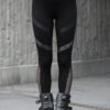 Black cotton lycra leggings designed with vegan leather stripe and patterned silver stripe underneath, with a transparent net on the calf. Comfortable to wear any season.