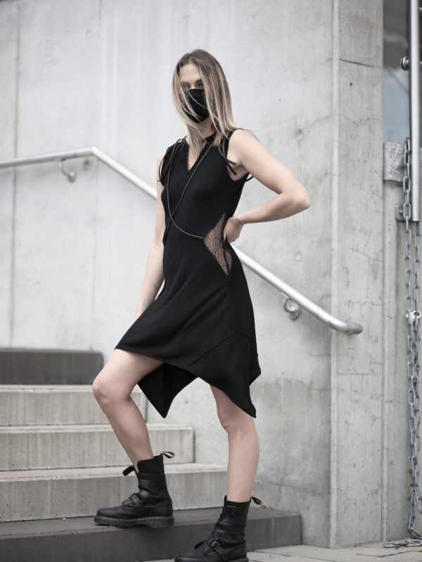 Black viscose dress designed with transparent net and vegan leather stripes.