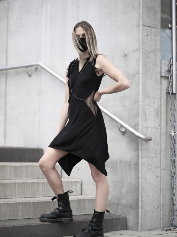 Black viscose dress designed with transparent net and vegan leather stripes.
