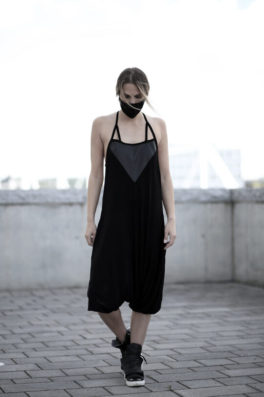 Black viscose jumpsuit designed with vegan leather with pockets. A loose jumpsuit for women in love with dark fashion and alternative fashion style.
