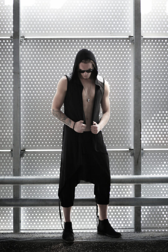 Men's black viscose asymmetric cardigan designed with silver patterned fabric with pockets. A piece of designer clothes for men from the latest Kali Rose fashion collection - BIOHAZARDOUS