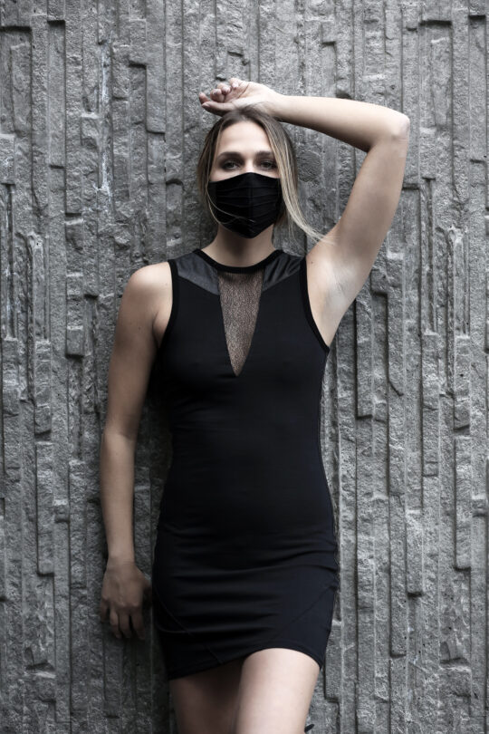 Black cotton lycra dress designed with vegan leather and transparent net.