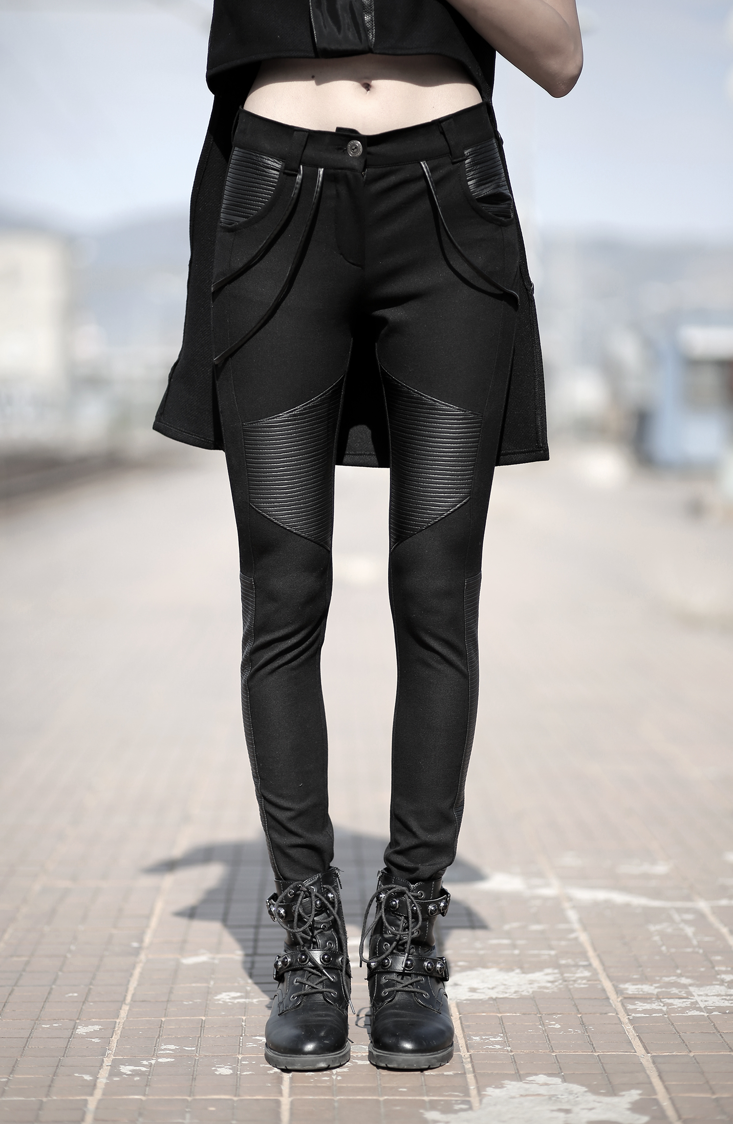 Black jeans designed with fake leather. Tight fit. Unique autumn/winter designer pants. Cyberpunk.