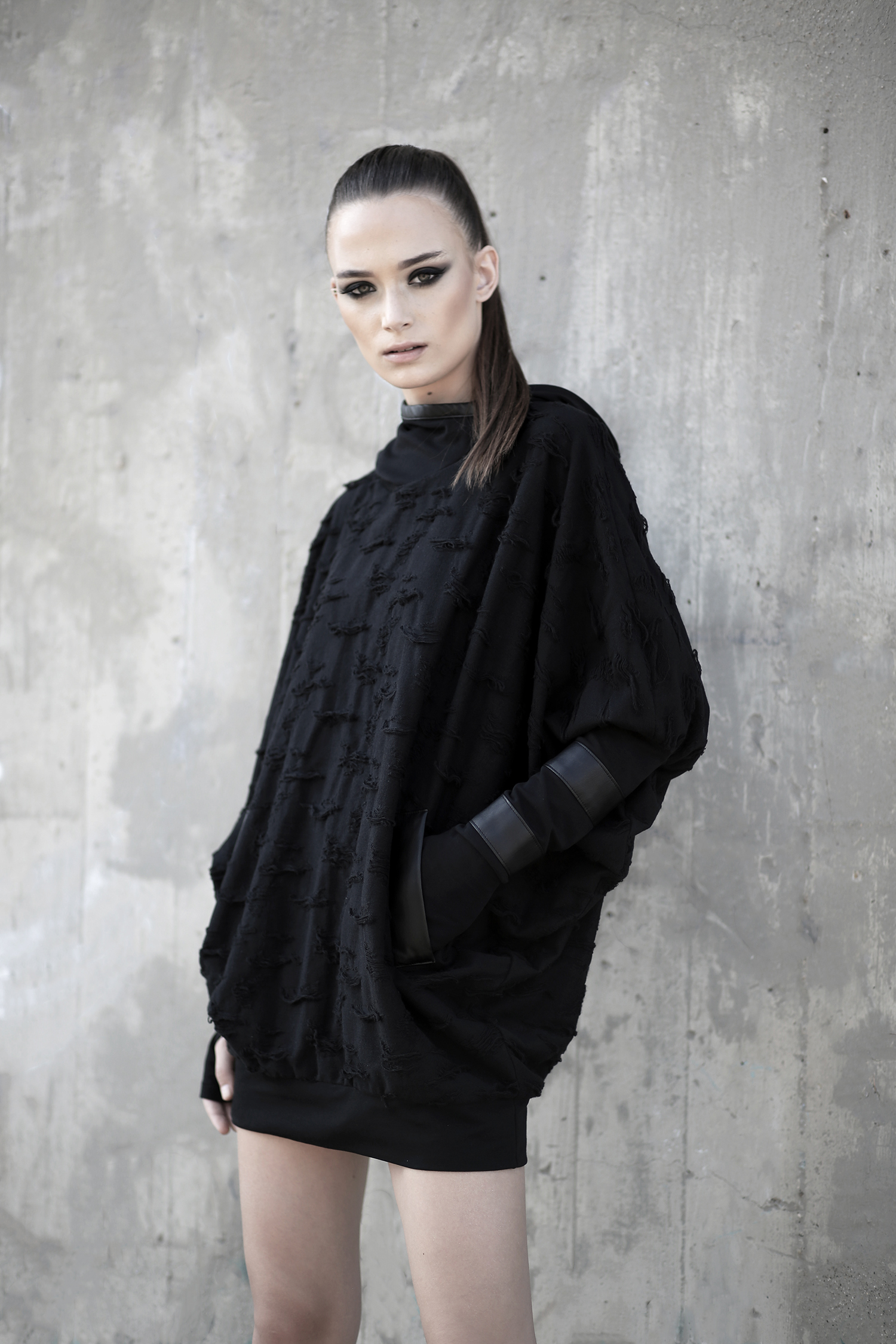 Ripped cotton poncho with double layered hoodie. Faux leather details on the sleeves and back side. Women loose poncho. Cyberpunk fashion.