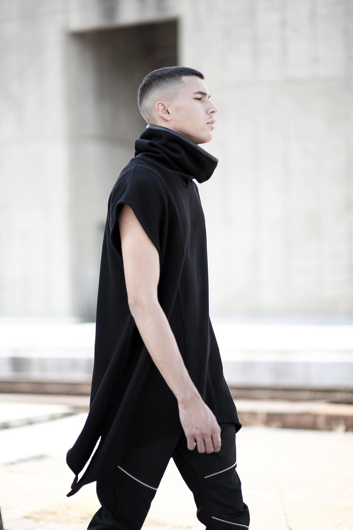 Man poncho made of quality blend wool felt, mix of 2 patterns designed with faux leather stripe on the back. A perfect designer piece for alternative and black fashion lovers.