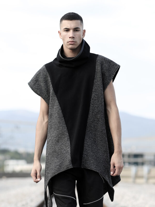 Man Poncho made of quality blend wool felt, mix of 2 patterns designed with faux leather stripe on the back. You can wear it on the top of a blouse or jacket.
