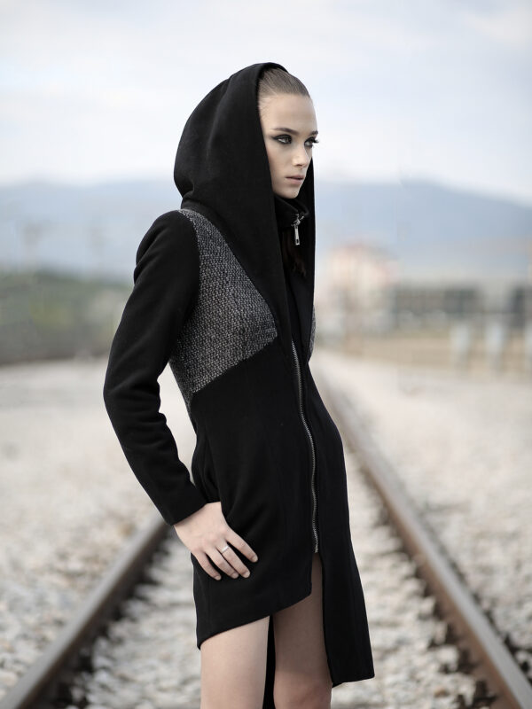 Black coat made of quality blend wool felt in 2 different patterns, with lining. No pockets as it's slim fit coat.