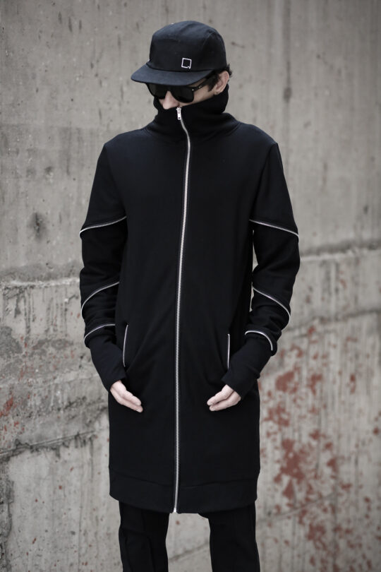 Soft cotton long jacket designed with non functional zippers. With pockets.